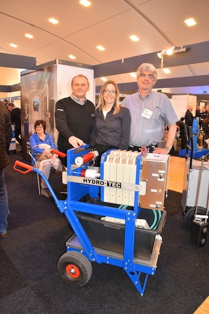 Hydro-Tec's cofounder Roland Kirsch, Marie Peil of Tractive, Hydro-Tec's cofounder Jürgen Kimmel presenting the in-house designed mobile concrete splitting press at BeBoSa 2017.